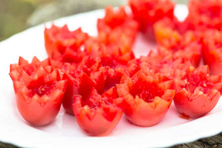 nicely: Nicely flower sliced tomatoes on a plate. Stock Photo