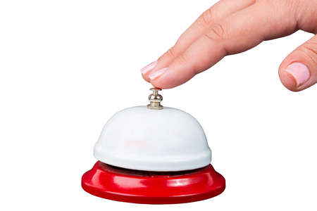 attract attention: Service concept. Womans hand above bell isolated on white background Stock Photo