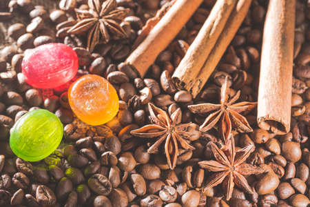 anis: Anise stars , coffee beans, cinnamon sticks and colorful candies. Stock Photo