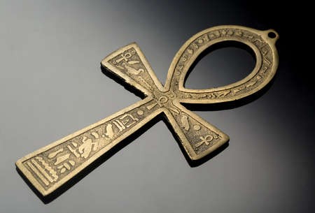 Egyptian symbol of life Ankh on nice silver black background.