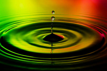bubble level: Abstract photo of water drops on nice red yellow green background. Nice texture and design photo. Stock Photo