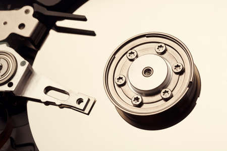 microscopical: Spindle and plate open hard disk drive. Macro shot. Stock Photo