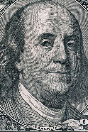 Vertical portrait of Benjamin Franklins face on the US 100 dollar bill. Macro shot. Stock Photo