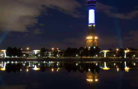 Moscow ostankino TV Tower with pond and reflections at night.