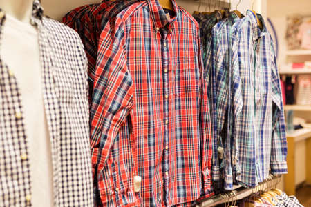 strip shirt: Various shirts in men clothes store in shopping mall for sale. Stock Photo
