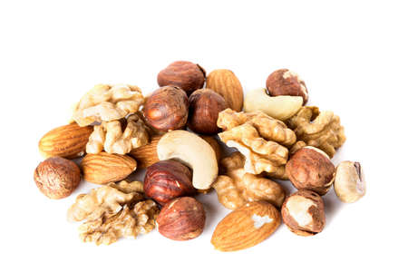 Heap from various kinds of nuts almond, walnut, hazelnut, cashew, Brazil nut isolated on white