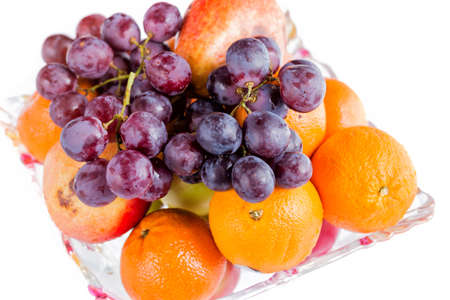 close uo: Oranges and grape in a bowl close uo isolated on white