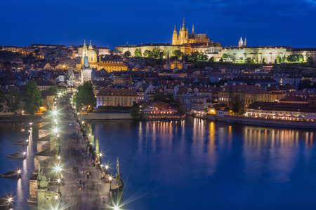 View of Charles Bridge, Prague Castle and Vltava river in Prague, Czech Republic during blue hour.
