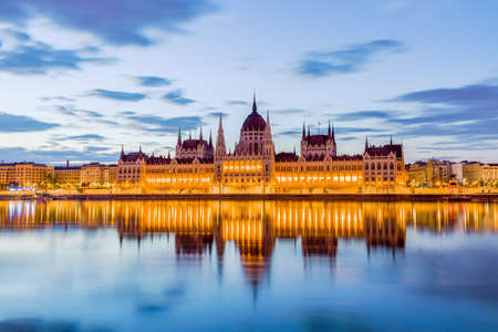 Parliament and riverside in Budapest Hungary during sunrise.