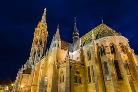 View of the Matthias Church during blue hour, roman catholic church located in Budapest, Hungary inside Fishermans Bastion at the heart of Budas Castle.