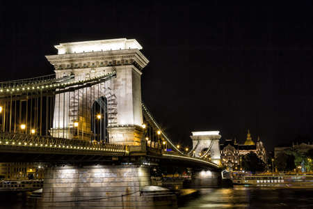 building a chain: Szechenyi Chain Bridge at night in the city of Budapest, Hungary.