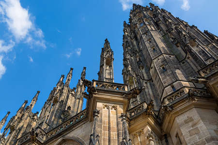 Closeup view on gothic cathedral of St. Vitus with blue sky in Prague Castle, Prague, Czech Republic.