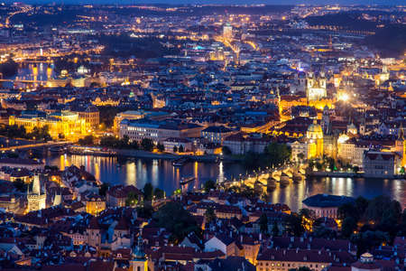 Prague at twilight blue hour, view of Charles Bridge on Vltava with Mala Strana and Old Town. Stock Photo
