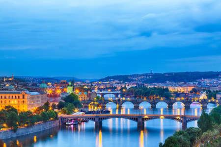 Prague at twilight blue hor, view of Bridges on Vltava