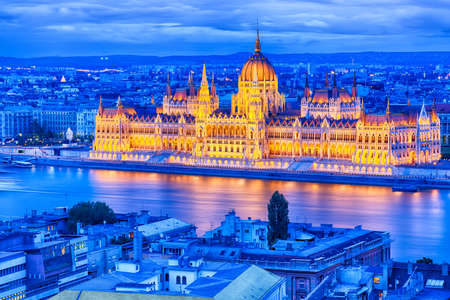 Parliament and riverside in Budapest Hungary during blue hour sunset.