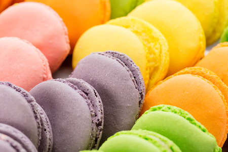 Collection of colorful French macarons closeup as a background. Selective focus. Stock Photo