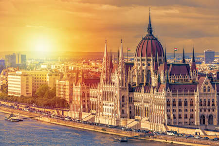 Travel and european tourism concept. Parliament and riverside in Budapest Hungary with sightseeing ships during summer day sunset Stock Photo