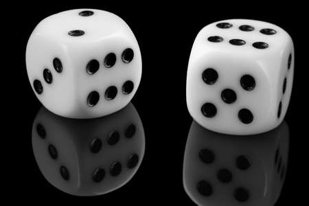 White Dice On Black Background with reflection close up. 版權商用圖片