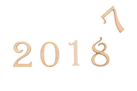 Happy New Year 2018 of real wooden figures with a figure of 7. isolated on white.
