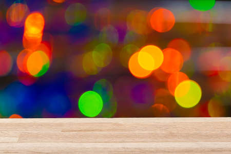 Empty light wood table top with colorful background. Can be used for new year, christmas or any holiday event project or template.