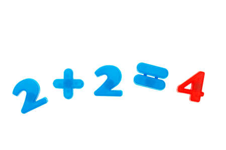 Two plus two is equal to four of the colored numbers magnets isolated on white background. Mathematics concept
