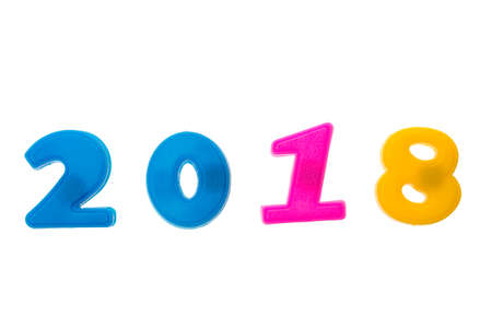 Happy New Year 2018 of real colorful magnet figures numbers isolated on white.