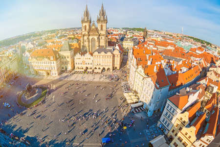 PRAGUE, CZECH REPUBLIC - MAY, 2017: Tourism in Europe. Buildings on the Old Town square Staromestska Namesti from old astronomical clock tower Orloj in Prague, Czech Republic during sunset. Fish-eye lens.