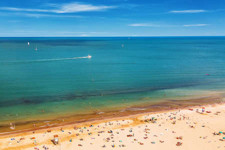 Aerial view of Rimini beach with people, ships and blue sky. Summer vacation concept