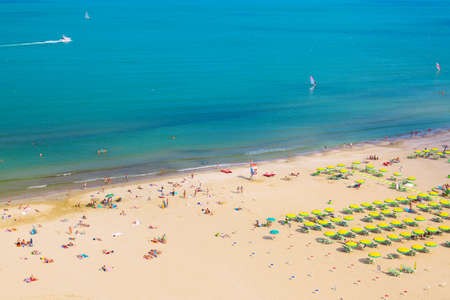 Aerial view of Rimini beach with people and blue water. Summer vacation concept