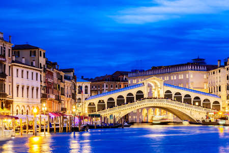 Venice, Italy. Rialto bridge and Grand Canal at twilight blue hour. Tourism and travel concept Archivio Fotografico