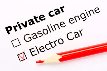 Questionnaire. White paper sheet with checkboxes and red pencil. Survey asks the persons about private car engine: gasoline or electro