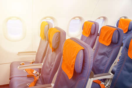 Blue airplane empty seats with windows. Aircraft interior
