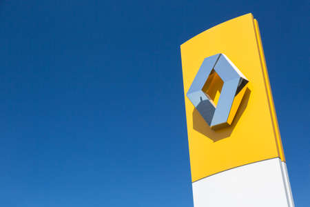 Moscow, Russia - May, 2018: Renault automobile dealership sign against blue sky. Renault-Nissan alliance is one of the biggest car manufacturers in the world Редакционное