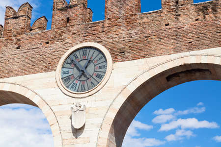 Old clock of the medieval Porta Nuova, gate to the old town of Verona. Piazza Bra in Verona. Veneto region, Italy Stock Photo