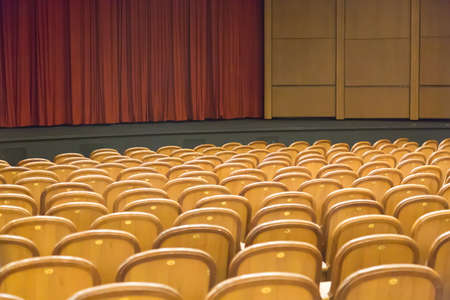 Brown vintage seats armchairs in theater. Theater or conference room interior Archivio Fotografico