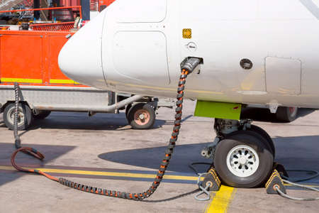 Refueling the aircraft. Tanking small airplane outdoors. Transportation concept Reklamní fotografie