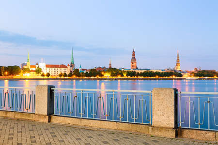 Sunset evening view of Riga cityline panorama over river Daugava with all landmarks of old town. View from Daugava quay Stock Photo