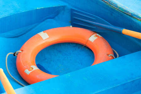 Rubber safety ring on a blue boat.