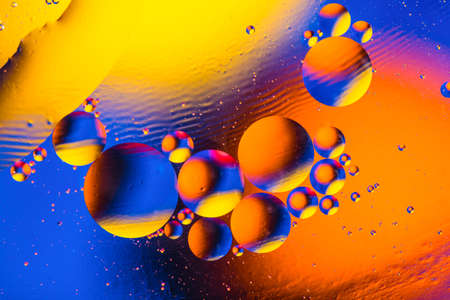 Abstract colorful background with oil drops and reflections on water surface. Cosmic abstract image.