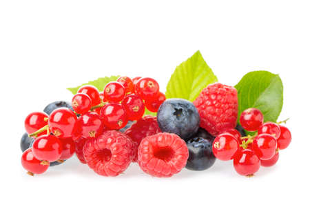 Healthy fresh food berries group. Macro shot of fresh raspberries, blueberries, blackberries, red currant and blackberry with leaves isolated on white background