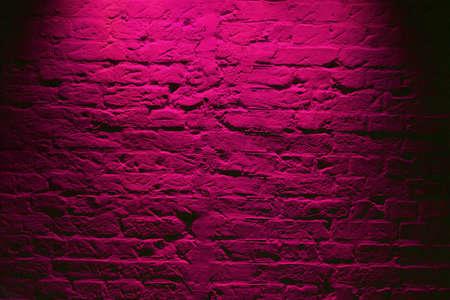 Grunge neon pink brick wall texture background. Magenta colored brick wall texture architecture pattern