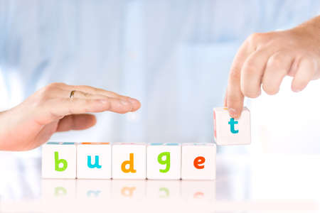 Accounting banking finance or business concept. Male hands collect word Budget from cubes Stock Photo