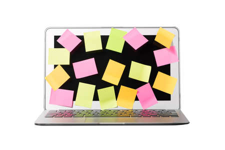 Many blank sticky notes covering a laptop screen isolated white background. Concept of deadlines or ideas. Фото со стока