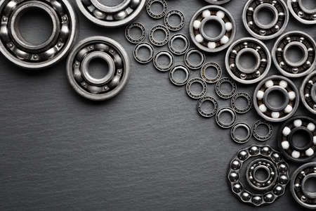 Frame of various ball bearings with free space. Technology and machinery industrial background