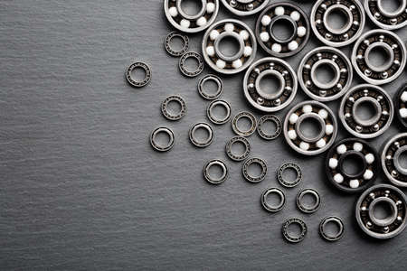 Frame of various ball bearings with free space. Technology and machinery industrial background Reklamní fotografie