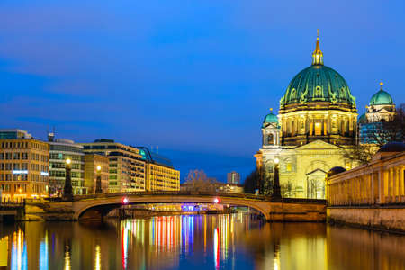 Berlin cathedral Berliner Dom in the evening twilight sunset with Spree river and reflections. Berlin, Germany 版權商用圖片