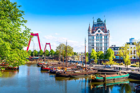 Rotterdam, South Holland, The Netherlands - May, 2018: Oude Haven harbor, Willemsbrug bridge, old ship yard dock, Ships, Openlucht Binnenvaart Museum during sunny summer day in Rotterdam Editorial