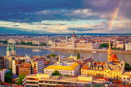Rainbow near Parlament and riverside of Danube river in Budapest, Hungary. Reklamní fotografie