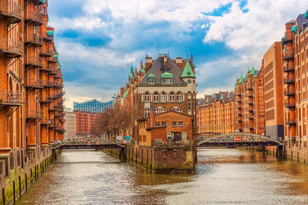 The Warehouse district Speicherstadt during spring in Hamburg, Germany. Warehouses in Hafencity quarter in Hamburg Imagens