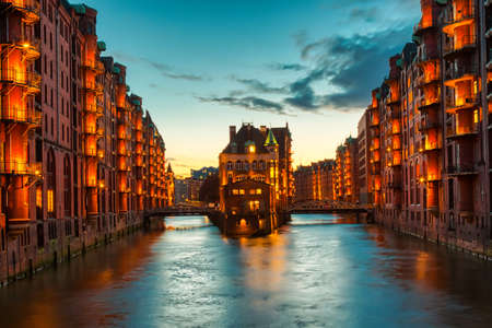 The Warehouse district Speicherstadt during twilight sunset in Hamburg, Germany. Illuminated warehouses in Hafencity quarter in Hamburg